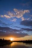 замок моста над водой захода солнца Стоковая Фотография