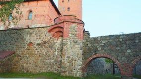 Замок на заходе солнца, Литва острова Trakai видеоматериал