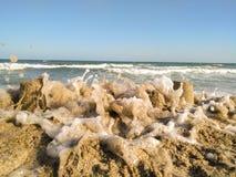 Замок песка разрушенный волнами Стоковое Фото