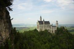 Замок Hohenschwangau и озеро Alpsee Стоковые Изображения