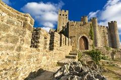 Замок Obidos, средневековая укрепленная деревня в Португалии Стоковая Фотография RF