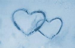 замороженное окно сердец Стоковые Изображения