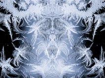 Замороженные ледяные кристаллы зимы на стекле Стоковые Фотографии RF