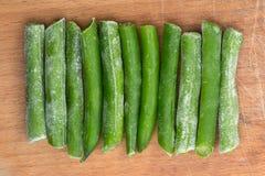 Замороженные 11 ручек спаржи на деревянной предпосылке Стоковые Фото