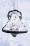 Замороженные seesaws покрытые с снегом и льдом Стоковое Изображение