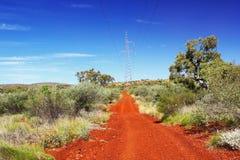 Замотка грязной улицы до австралиец Буш, Karijini Стоковая Фотография