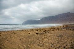 Занимаясь серфингом Ла Caleta пляжа Стоковая Фотография RF