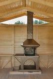 Заново построенный каменный гриль в деревянном павильоне Стоковые Изображения