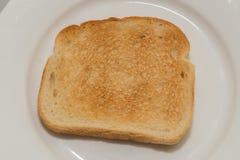 Заново провозглашанный тост хлеб на плите Стоковое фото RF