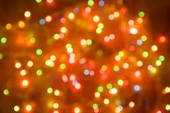 Запачканная гирлянда рождества абстрактное bokeh предпосылки цветастое Блестящее украшение праздника Стоковое Изображение RF