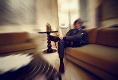 Запачканная красочная предпосылка бизнесмена в роскошном интерьере Стоковое Фото