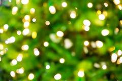 Запачканная предпосылка с bokeh освещает на зеленом цвете/крупном плане запачканный Стоковое Фото