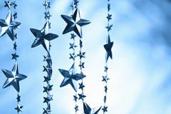 Запачканная предпосылка с гирляндой звезд Стоковая Фотография