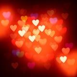 Запачканная defocused предпосылка светов с сердцами Стоковые Фотографии RF