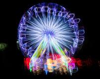 Запачканное гигантское колесо, ferris на ноче Стоковые Фотографии RF