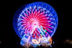 Запачканное гигантское колесо, ferris на ноче Стоковые Фото