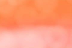 Запачканное bokeh абстрактного градиента предпосылки оранжевое розовое стоковое изображение
