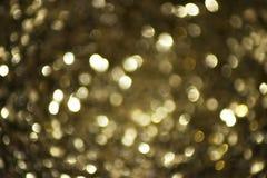 Запачканные света с предпосылкой влияния bokeh золотой Стоковые Изображения RF