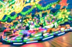 Запачканные defocused света на карусели carousel Luna Park Стоковые Фото