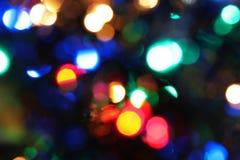 Запачканный взгляд накаляя светов рождества Стоковое Фото
