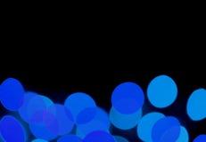 Запачканный, Bokeh, из фокуса, Defocused живых голубых светов на черной предпосылке, с открытым космосом для дизайна Стоковое фото RF