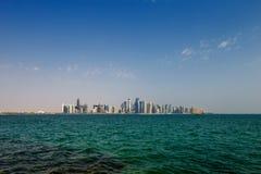 Западный горизонт Bay City Дохи, Катара Стоковая Фотография RF