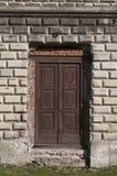 Запертый старый вход двери в дворец Стоковые Изображения