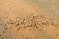 Запись на песке пляжа Стоковые Фотографии RF