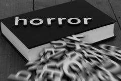 Запишите роман при ужас слова и запачканные письма приходя из страниц Стоковые Изображения