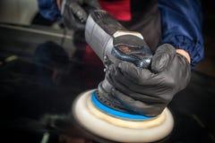 Заполированность человека черный бампер металла стоковое изображение rf