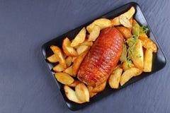 Заполненная грудь индюка испеченная с картошкой Стоковое фото RF