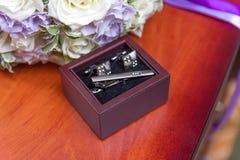 Запонки для манжет свадьбы стоковое фото