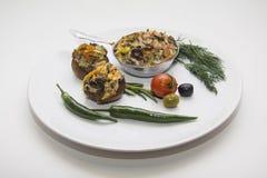 Заполненные champignons на плите Стоковая Фотография