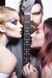 запрета Диапазон музыки с гитарой Диапазон музыкантов с guital Музыкальные гитаристы диапазона стоковое фото
