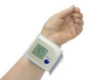 запястье руки давления монитора крови Стоковая Фотография