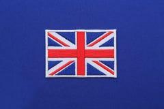 Заплата флага Великобритании на ткани стоковое изображение rf