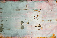 Заржавейте на голубом и розовом старом покрашенном металле Стоковая Фотография