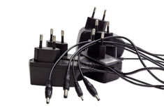 Заряжатели батареи для различных устройств на светлой предпосылке Стоковое Изображение
