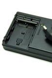 Заряжатель батареи камеры на белой предпосылке Стоковые Фотографии RF