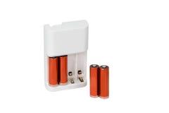 Заряжатель батареи при изолированные батареи Стоковое фото RF