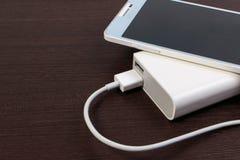 Заряжатель кабеля USB с банком энергии Стоковая Фотография RF