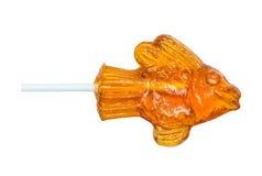 Засахарите леденец на палочке сделанный в форме рыб, рыбки на деревянной ручке Стоковое Изображение RF