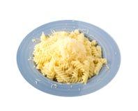 Заскрежетанный сыр на макаронных изделиях Стоковое Фото