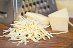 заскрежетанный сыр Стоковые Фотографии RF
