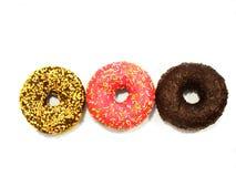 3 застеклили donuts изолированные на белой предпосылке Стоковая Фотография