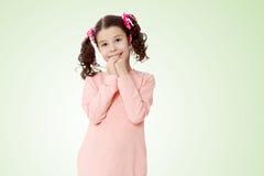 Застенчивая девушка держа руки около стороны Стоковая Фотография RF