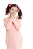 Застенчивая девушка держа руки около стороны Стоковые Фотографии RF