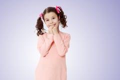 Застенчивая девушка держа руки около стороны Стоковое фото RF