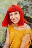Застенчивая красная с волосами женщина Стоковое Изображение