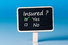 Застрахованный - да или нет Вопрос о страховании - вы покрыли стоковое фото rf